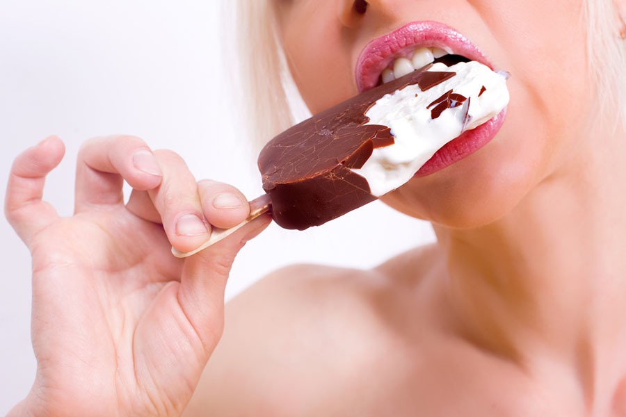 Blonde biting Ice Cream on stick 900x600