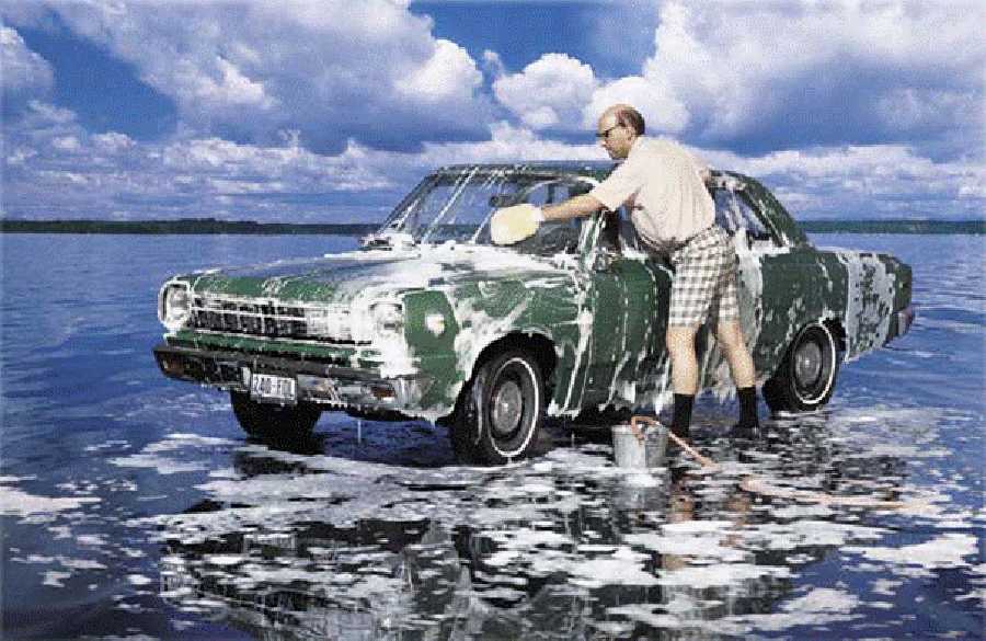Man washes his car in Shorts 900x585