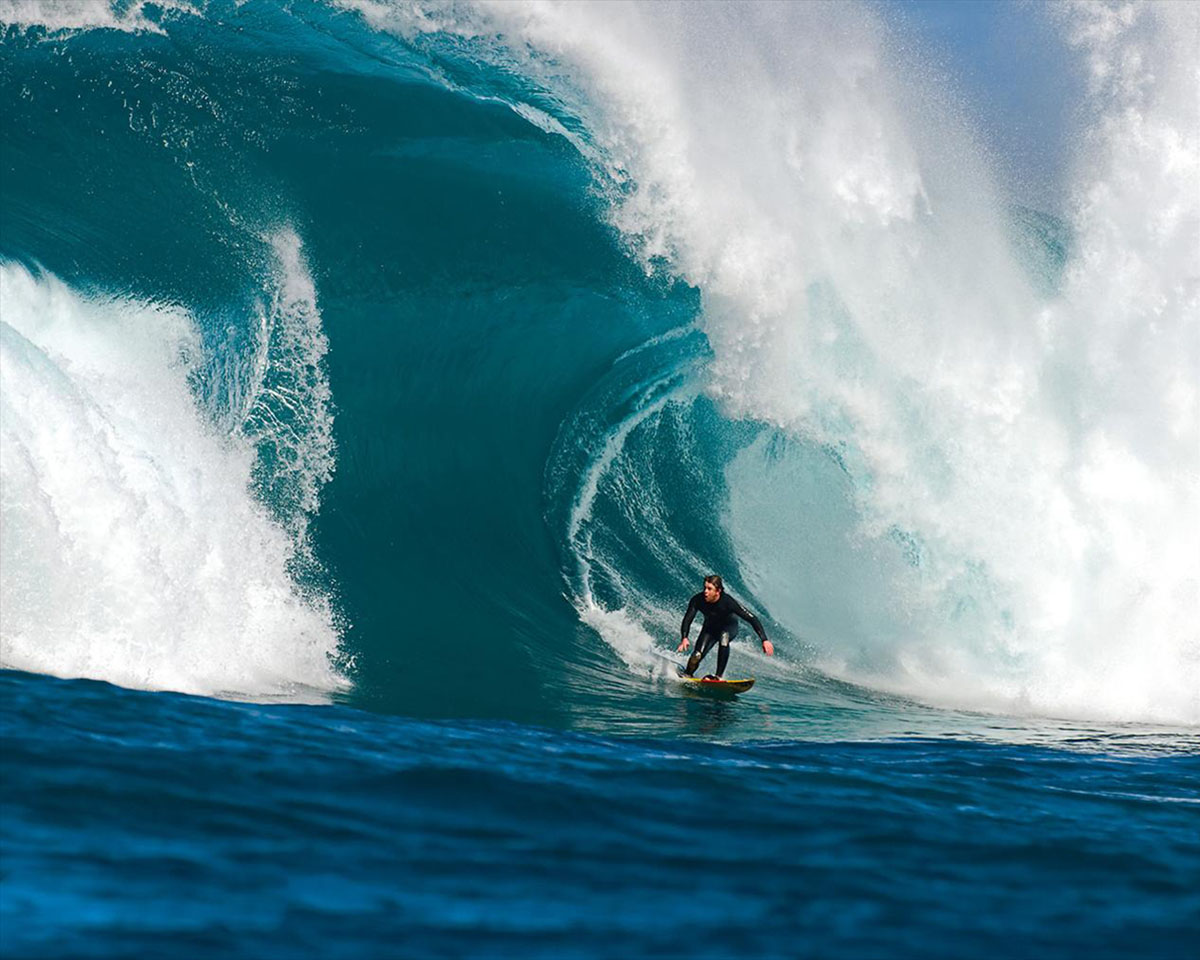 scared-surfer-under-wave-1200x960